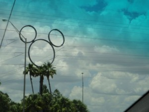 Large Mickey Balanced On Palm Tree