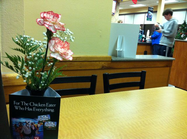 Fresh Flower Bud Vase At A Fast Food Outlet